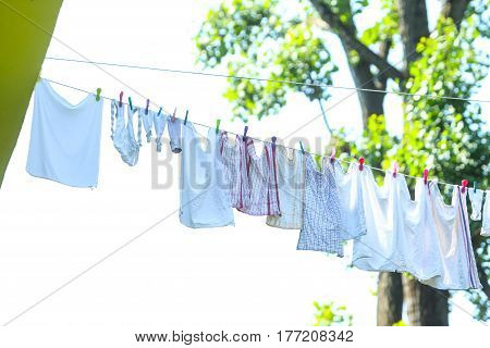 A view of laundry on a washing line in nature.