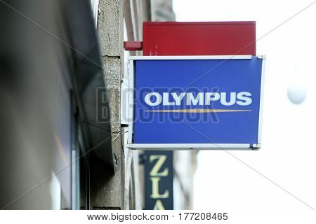 ZAGREB CROATIA - FEBRUARY 24 : Olympus shop sign on the street in city centre on February 24th 2014 in Zagreb Croatia. Olympus is a Japan-based manufacturer of optics and reprography products.