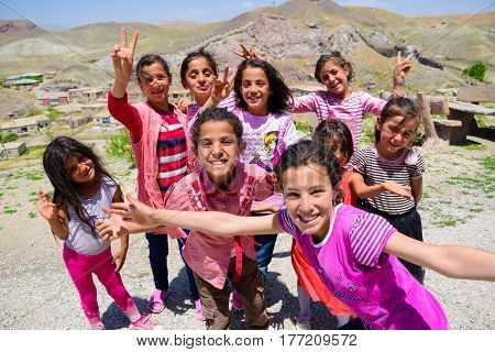 Van Turkey-July 7 2015: Happy Kurdish girls are smiling and posting for pictures in front of Hosap castle in Van