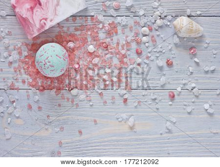 Spa background with bath bombs aromatherapy salthandmade soap bar and seashells.Top view.
