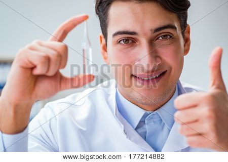Doctor holding medicines in the lab