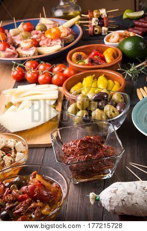Spanish Tapas Appetizers On Wooden Table