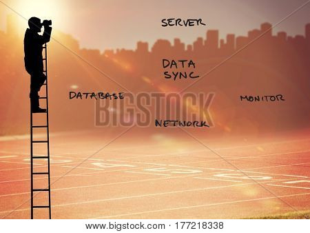 Digital composite of Businessman Silhouette on a Ladder looking at future against an orange city landscape background