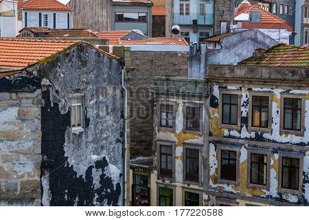 Old red tiled roofs houses in Porto city Portugal
