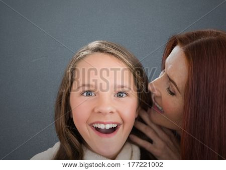 Digital composite of Mother and Daughter Smilling against a grey background