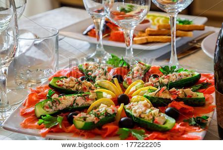 Decorated banquet table with various snacks and sandwiches at a festive event or wedding celebration