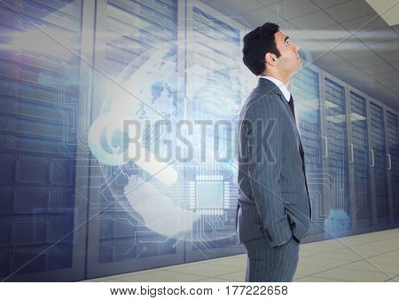 Digital composite of Businessman Standing looking at Graphic against a blue background