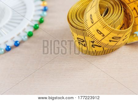 Curved measuring tape with copyspace. Measuring tape of the tailor. Closeup view of yellow measuring tape
