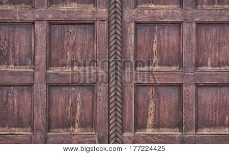 Wooden panel of burgundy-brown color from square laths