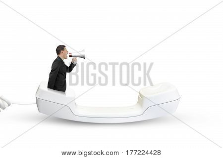 Man Using Speaker Yelling With Telephone Handset
