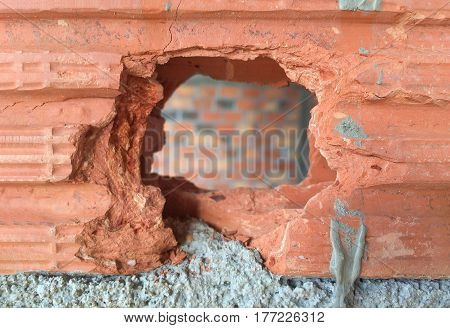 Broken brick.General maintenance and open hole concept.