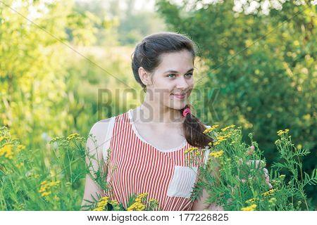 Russian cute girl on a wild meadow