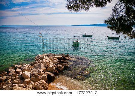 boats floating near the shore in Brela, Makarska Riviera, Croatia
