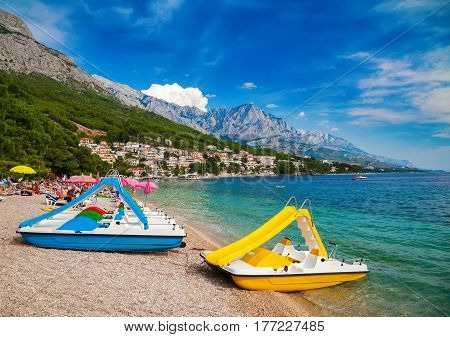 catamarans on a beautiful beach in Brela, Makarska Riviera, Croatia