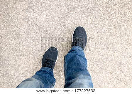 Top view of Men wear jeans and black sneakers