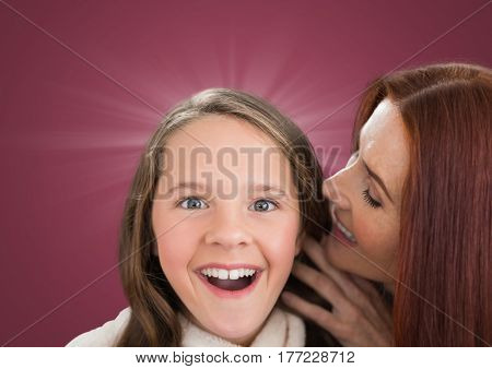Digital composite of Mother speaking to her dautgher ear against a dark pink background