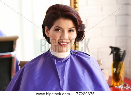 Young woman with beautiful haircut in beauty salon