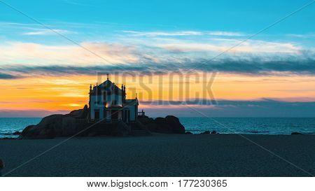 Miramar Beach and Chapel Senhor da Pedra at night, Portugal.
