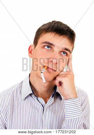 Pensive Young Man with a Broken Cigarette Isolated on the White