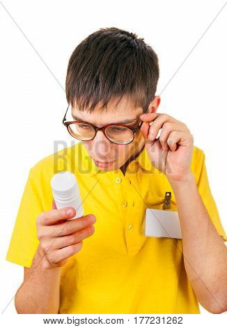 Surprised Young Man with White Vial Isolated on the White Background