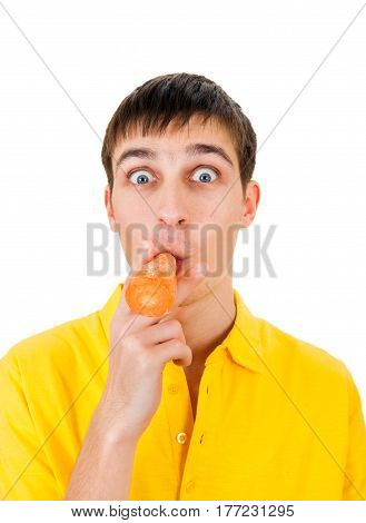 Surprised Young Man with a Carrot in his Mouth Isolated on the White Background