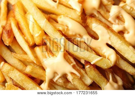 Delicious cheese fries as background