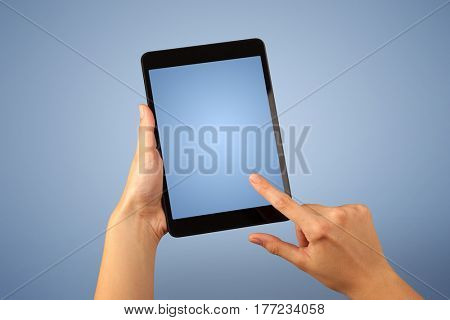 Female fingers touching blank tablet
