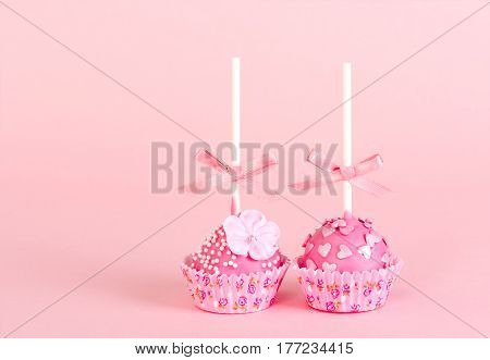 Two Pop Cake With Pink Glaze And Decor