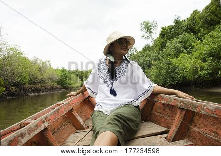 Traveller Thai Woman Sit On Service Long Tail Boat For Looking And Travel View Riverbank And Mangrov