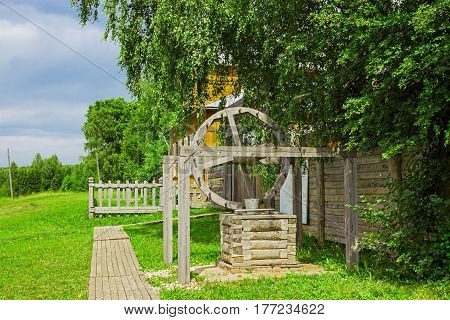 Wooden well in the countryside in summer in Russia