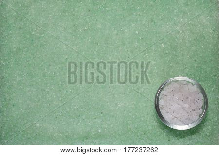 Background with mint green and white sea salt, closeup