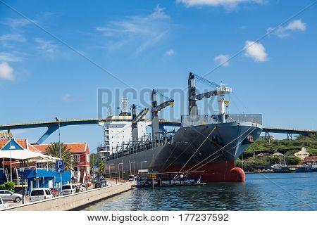 Massive Tanker Docked in Curacao by Bridge