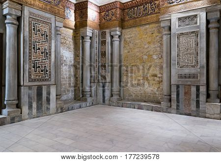 Cairo, Egypt - March 18 2017: Interior view of decorated marble walls surrounding the cenotaph in the mausoleum of Sultan Qalawun, part of Sultan Qalawun Complex, 1285 AD, located in Al Moez Street