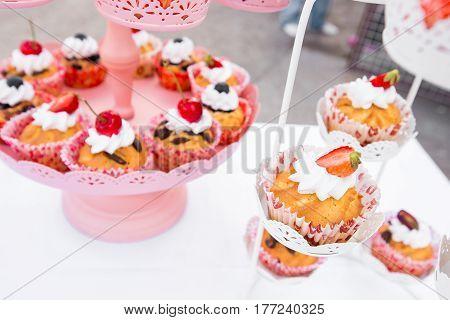 wedding cupcakes in iron baskets. Horizontal image