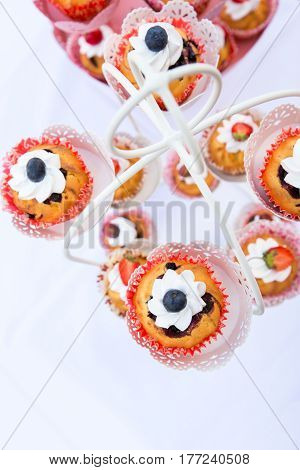 wedding cupcakes in iron baskets. Vertical image