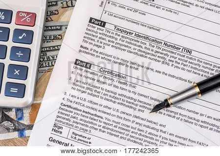 Tax Form - W9 - With Dollar And Pen.