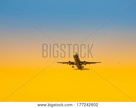 Aircraft take-off from airport at sunset time. Air transportation and leaving on holiday theme.
