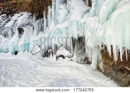 Snow On Splashed Ice On Coastal Rock