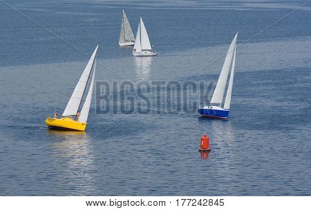 Unsuccessful turn in yachting race on a summer river.