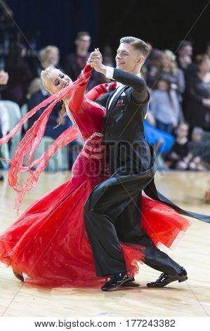 Minsk Belarus-February 182017:Couple of Buldyk Sergey and Raiko Alena Performs Youth Standard European Program on WDSF Minsk Open Dance Festival-2017 Championship in February 182017MinskBelarus.