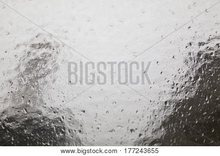 structural glass pane with rain drops and compositions