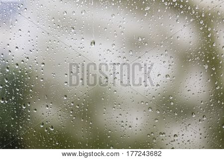 raindrops on a window for backgrounds and compositions