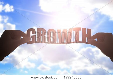 silhouette of hand take growth word with blue sky