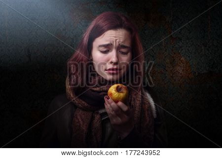 Hungry Woman Looking On A Rotten Apple