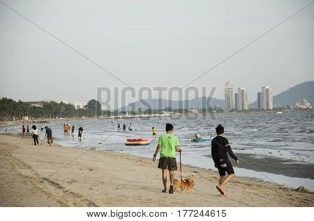 Thai People And Traveler Travel Relax And Playing Wave And Sea On The Beach At Bangsaen