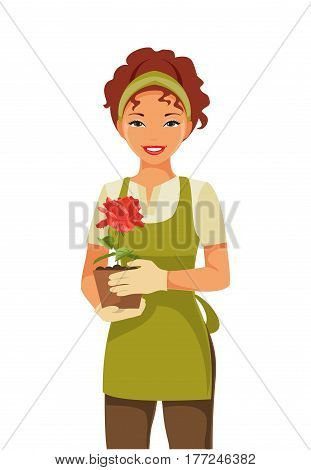 Young woman gardener holding a pot of roses in hands