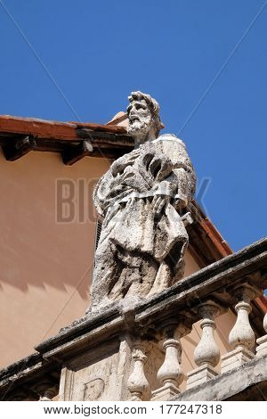 ROME, ITALY - SEPTEMBER 03: Statue of Apostle on the church dei Santi XII Apostoli in Rome, Italy on September 03, 2016.