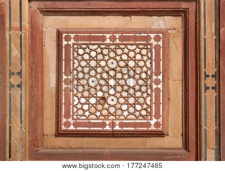 FATEHPUR SIKRI, INDIA - FEBRUARY 15: Beautiful stone carvings on the wall in Fatehpur Sikri complex, Uttar Pradesh, India on February 15, 2016.