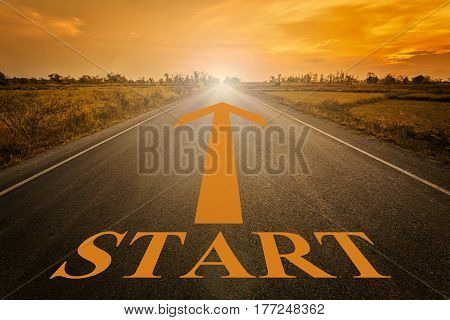 Empty blur asphalt road and sunlight and sign which symbol success. Concept for start.