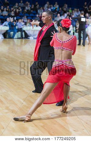 Minsk Belarus-February 18 2017: Pro-Am Dance Couple Performs Pro-Am Super Cup International Latin Program on WDSF Minsk Open Dance Festival-2017 Championship in February 18 2017 in Minsk Belarus.